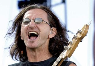Geddy Lee of Rush perform during the concert for SARS relief at Downsview Park in Toronto Wednesday July 30, 2003. (CP PHOTO/Aaron Harris) closecut close cut