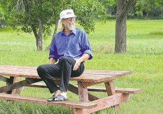 Craig Cobb sits on a picnic bench on a property in Leith, N.D., where he would like to hold a white-power music festival.