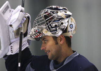 Winnipeg Jets goaltender Odrej Pavelec takes a break during the Winnipeg Jets practice at the MTS Iceplex today.