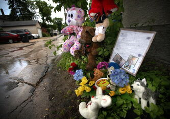 A memorial was erected by neighbours at the site where Robert Scherban was killed Sunday.