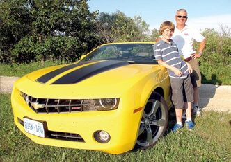 Mark Richardson and his 12-year old son Tristan are driving across the country on the Trans-Canada Highway in a 2012 Chevrolet Camaro convertible.