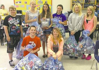 Students from Ms. Pawluk's Grade 8 class at Dr. George Johnson School in Gimli have joined  the Tabs for Alex program and are challenging other classes at their school to collect the most cans.