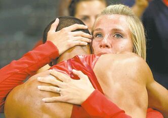 Ashton Eaton is embraced by Brianne Theisen  after he won the decathlon at the 2012 Summer Olympics.