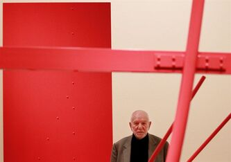 "FILE - This is a Tuesday, Jan. 18, 2011 file photo of sculptor Anthony Caro as he poses for photographs with his sculpture ""Early One Morning"" during the press view for the ""Modern British Sculpture"" exhibition at the Royal Academy of Arts in London. A statement released on behalf of the artist's family Thursday Oct. 24, 2013, said Caro died after suffering a heart attack on Wednesday. Caro was one of Britain's best-known artists, and his large, abstract steel sculptures � usually placed directly on the ground � stand in galleries, museums and parks around the world. (AP Photo/Matt Dunham, File)"