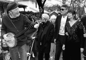 In an April 12, 1989 file photo, film producer Bert Schneider, second from right, joins in a march lead by folk singer Pete Seeger, left, from the family home of Abbie Hoffman in Worcester, Mass., to Temple Emanuel for a memorial service for the former political activist.