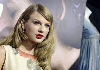 FILE - This Sept. 24, 2013 file photo shows singer Taylor Swift at the premiere of the