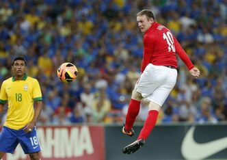 England's Wayne Rooney (right)  will miss two World Cup qualifiers after cutting his forehead in training Saturday.