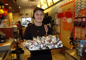 Michelle Winter brings out a tray full of Teen Burgers at the Polo Park Portage Avenue location during a Cruisin' for a Cause Day in 2010.