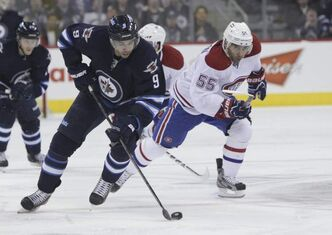 Winnipeg Jets' Evander Kane (9) moves the puck up the ice on a breakaway with Montreal Canadiens' Francis Bouillon (55) hot on his heels at the MTS Centre Thursday evening.
