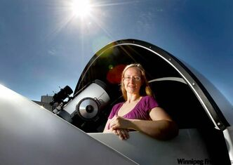 Jennifer West, shown in the Ewen Campus Observatory at the University of Manitoba , won the top Dark Sky Defender award in the student category for her videos.