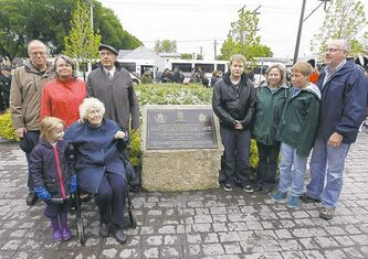Family members of Leo Clarke stand next to a plaque honouring him following a dedication ceremony on Valour Road at Sargent Avenue on Sunday. He was one of three Victoria Cross recipients who lived on Pine Street, which was renamed Valour Road in their honour.