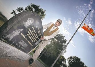 Donald Mackey, who served with Sgt. Tommy Prince in 1951, stands with the now-repaired memorial.