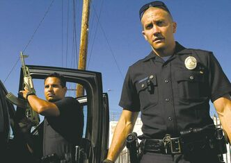 "Jake Gyllenhaal (right) and Michael Pena star as police offers in ""End of Watch."" (Courtesy Scott Garfield/MCT)"