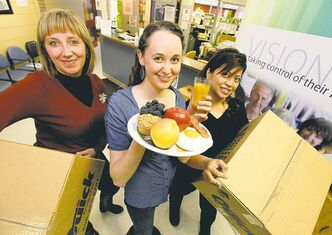 From the ground up (from left): NorWest Co-op community development co-ordinator Michelle Kirkbride, food centre  director Kristina McMillan and primary care assistant Marsha Gravador are getting ready to serve up some healthy meals.  treats.  3 with moving boxes in what is to become the NorWest Community Food Centre (CFC) when the Co-op health centre moves to it�s new office.