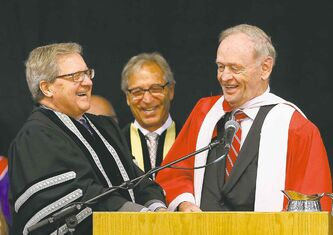 University  of Winnipeg  chancellor Robert Silver looks on as  vice-chancellor Lloyd Axworthy (left) shares a laugh with his  former political boss, Jean  Chretien, during convocation  ceremonies Thursday.