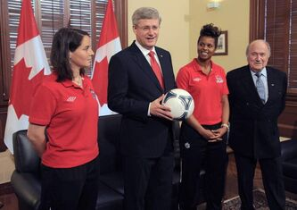 Prime Minister Stephen Harper with team Canada members Rhian Wilkinson, left, Karina Leblanc, and FIFA President Sepp Blatter in the Langevin office in Ottawa on Friday. Canada will host the FIFA Women's World Cup soccer tournament in 2015.