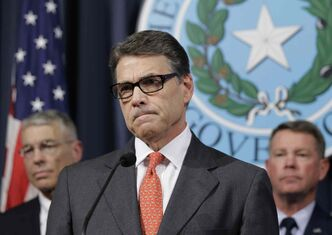 Gov. Rick Perry listens to a reporter's question during a news conference in the Governor's press room, Monday, July 21, 2014, in Austin, Texas. Gov. Perry announced he is deploying up to 1,000 National Guard troops over the next month to the Texas-Mexico border to combat criminals that Republican state leaders say are exploiting a surge of children and families entering the U.S. illegally.