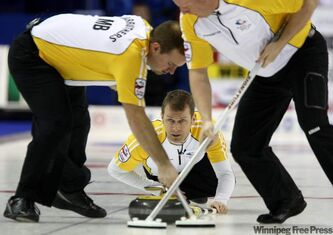 Manitoba skip Jeff Stoughton watches his shot between second Reid Carruthers (left) and lead Steve Gould in draw 3 against Nova Scotia at the Brier Canadian Curling Championship in London, Ont., on Sunday.