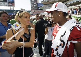 TV Azteca reporter Ines Sainz, left,  with Arizona Cardinals wide receiver Steve Breaston, right. Sainz said she felt 'very uncomfortable!' at a Jets practice where a coach appeared to throw footballs in her direction and players called out to her in the locker room.