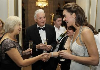 In this handout photo provided by Clarence House, Catherine, Duchess of Cambridge, right, speaks to guests as she attends an event in support of the 'In Kind Direct' charity at Clarence House London Wednesday Oct. 26, 2011 . The Duchess of Cambridge handled her first solo duties since her wedding to Prince William acting as a last minute stand in for father-in-law Prince Charles at a charity dinner in aid of 'In Kind Direct.' (AP Photo/ Paul Burns/Clarence House )