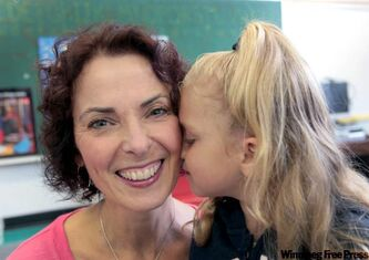 Teacher Wendy Challis shares a moment with student Brianna Stanko at Robertson School.