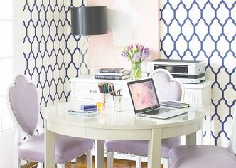 Stylish office pieces that can stay out and trays to control clutter will help your dining room look less like an office.