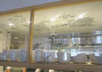Doodles on the glass wall of Pidgin's open kitchen.