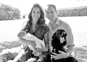 Prince William, the Duchess of Cambridge and their son, Prince George, and cocker spaniel Lupo.