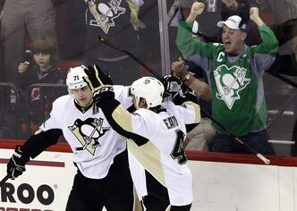 Pittsburgh Penguins' Evgeni Malkin (71), of Russia, and Mark Eaton (4) celebrate Malkin's goal against the Carolina Hurricanes during the third period of an NHL hockey game in Raleigh, N.C., Tuesday, April 9, 2013. Pittsburgh won 5-3. (AP Photo/Gerry Broome)