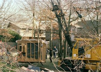 FILE - In a Jan. 18, 1993 file photo, a 30-foot-high crane raises the bunker out of the earth from the property of John Esposito in Bay Shore, N.Y. The cement and wood bunker, which contains a trap door, is 6 feet by 9 feet. Esposito is charged with keeping 10-year-old Katie Beers imprisoned in the bunker for 16 days. On the 20th anniversary of her ordeal, Beers has co-written a book with a television reporter who covered her kidnapping.