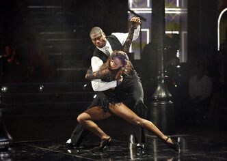 This May 13, 2013 photo released by ABC shows NFL football player Jacoby Jones and his partner Karina Smirnoff performing on the celebrity dance competition series