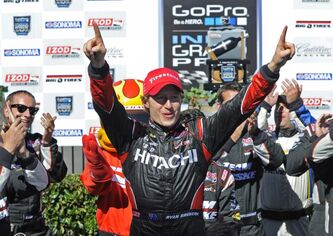 IndyCar driver Ryan Briscoe celebrates in the winner's circle after winning the Indy Grand Prix of Sonoma on Sunday.