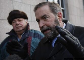 Thomas Mulcair (right), deputy leader of the federal NDP, spoke at at the Canadian Wheat Board office in Winnipeg.Mulcair, who is running to become leader of the party, got an endorsement from former Governor General and premier of Manitoba Ed Schreyer (left).