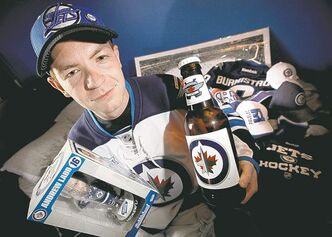 Winnipeg Jets fan Kevin Salmon with his Jets paraphernalia in his Winnipeg home. He says he'll be sitting on his wallet and won't be buying any more items during the lockout.
