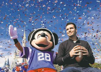 Baltimore's Super Bowl MVP Joe Flacco rides through Disney World's Magic Kingdom with Mickey Mouse during a parade in Lake Buena Vista, Fla., Monday.