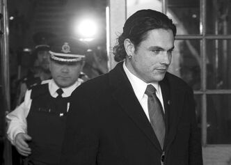 Sen. Patrick Brazeau leaves the Senate after being suspended on Feb. 12.