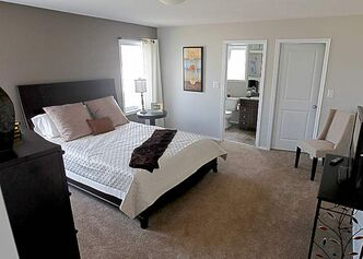 The master suite is nicely removed from the rest of the home and offers a secluded retreat.