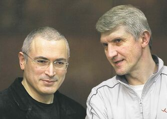 Mikhail Khodorkovsky (left) and co-defendant Platon Lebedev in court Aug. 6.