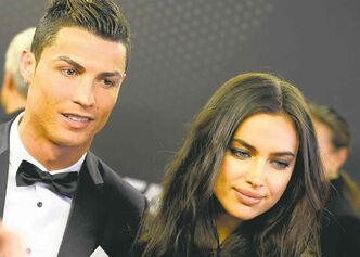 Cristiano Ronaldo of Portugal arrives with his girlfriend, Russian model Irina Shayk, on the red carpet prior to the FIFA Ballon d'Or 2013 gala.