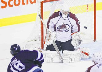 Jets captain Andrew Ladd snipes on Avalanche goaltender Reto Berra during first-period action at the MTS Centre.
