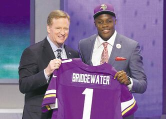 Louisville QB Teddy Bridgewater poses with NFL commissioner Roger Goodell after being selected by the Minnesota Vikings on Thursday night.