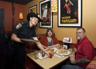 Tip a Cop at a Boston Pizza on Wednesday.