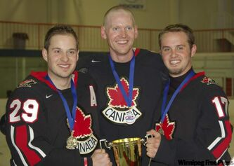 From left, Manitoba's Tom Rinn, Slade Doyle and Dennis Zboril with their hardware after winning the 2008 championship in Boston.