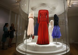 In this photo taken Monday, July 1, 2013, dresses of Princess Diana are displayed at the Fashion Rules exhibition at Kensington Palace in London, Monday, July 1, 2013. Opening on 4 July, a new glamorous exhibit at Kensington Palace showcases how the styles of three royal ladies; Queen Elizabeth II, her sometimes risque sister Margaret, and the glamorous Princess Diana, each reflected and influenced the trends of their fashion heyday. (AP Photo/Frank Augstein)