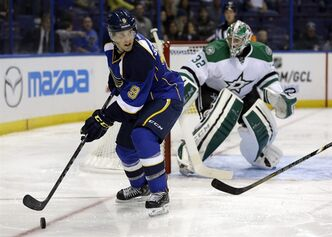 St. Louis Blues' Jaden Schwartz (9) looks to pass as Dallas Stars goalie Kari Lehtonen, of Finland, defends during the second period of a preseason NHL hockey game Saturday, Sept. 21, 2013, in St. Louis. (AP Photo/Jeff Roberson)