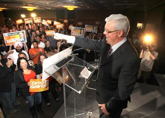 Premier Greg Selinger gives the thumbs up to hundreds of supporters at The Convention Centre after winning the election Tuesday night.