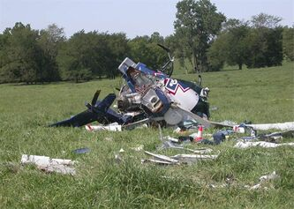 This photo provided by the National Transportation Safety Board, shows the wreckage of a helicopter that crashed near Mosby, Mo., on Aug. 26, 2011. The pilot of an emergency medical helicopter may have been distracted by text messages when he failed to refuel his helicopter and misjudged how far he could fly before running out of fuel. The helicopter crashed, killing the pilot and three others on board. Government investigators are expected to point the case as another example of the distracting role cellphones and other electronic devices are playing in transportation accidents. (AP Photo/NTSB)