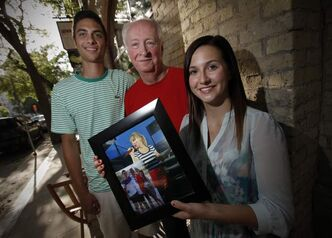 Quentin Raval, Ray Bernier and Roxanne Lacroix with a photo of the trio outside Saturday's Taylor Swift concert.