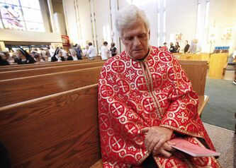 Rev. Msgr. Michael Buyachok reflects after Sunday's service at St. Joseph's Ukrainian Catholic Church in Winnipeg.