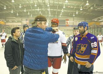 Director Michael Dowse, centre, with the cast of Goon.